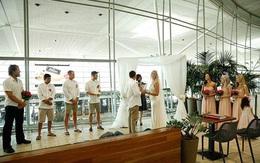 Bất chấp đám đông hỗn loạn do trục trặc kỹ thuật, một cặp đôi đã tổ chức lễ cưới ngay tại sân bay của Úc