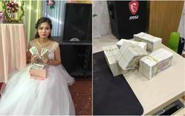 Mang hàng nghìn tờ tiền lẻ đi mừng cưới, thanh niên bị dân tình chỉ trích nhưng cô dâu có thái độ khác hẳn