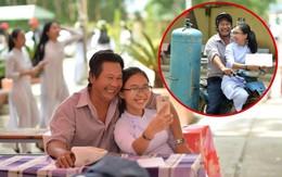 Ông bố đèo cả bình khí đi làm vẫn tranh thủ đến trường ''selfie'' cùng con gái trong lễ tổng kết cuối năm