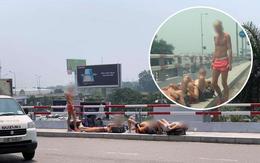 Giữa trưa nóng trên 40 độ C, 4 du khách nước ngoài vẫn vô tư cởi trần nằm phơi nắng ở sảnh sân bay Nội Bài