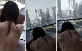 Video nhạy cảm của cặp đôi quay trong khách sạn có view nhìn ra tòa tháp nổi tiếng Thượng Hải lan truyền chóng mặt