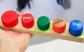 Các vật dụng nhỏ nhặt sẽ không còn thất lạc nếu bạn biết tận dụng nắp chai nhựa theo cách này