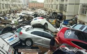 Trung Quốc: Mưa lũ kinh hoàng, ô tô bẹp dúm như đồ chơi, nước ngập tới 4m, bùn chất đống cao 1m