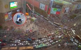 """Trung Quốc: Một người định tự tử, cả nghìn người vây xem, còn nằm lăn ra đường để tiện """"hóng"""""""
