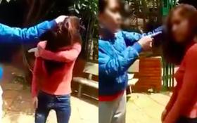 Người vợ túm tóc, tát liên tiếp vào mặt cô gái trẻ vì cố tình cặp kè với chồng mình