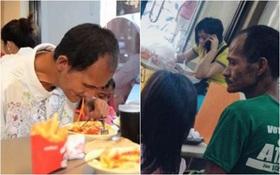 Số phận mỉm cười với người cha khắc khổ trong bức ảnh lặng lẽ nhìn 2 con gái nhỏ say sưa ăn gà rán