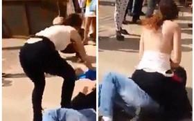 """Sự thật đằng sau đoạn video người phụ nữ cởi áo, dùng ngực """"tấn công"""" gã yêu râu xanh ở Brazil"""