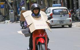 """Chùm ảnh: Nghìn lẻ một """"chiêu thức bá đạo"""" người dân Hà Nội đối phó với nắng nóng đỉnh điểm"""