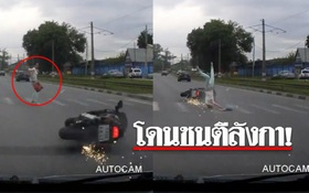 Đang sang đường, cô gái trẻ bất ngờ bị một chiếc xe máy không người lái từ xa văng trúng người