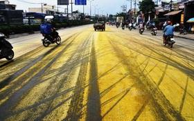 TP. HCM: Phanh gấp, hóa chất trên xe tải đổ xuống rải kín quốc lộ