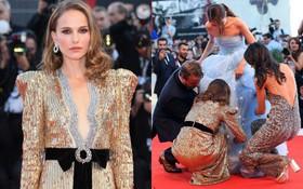 Trong khi nhiều sao nữ tị nạnh nhau, riêng Natalie Portman lại cúi mình chỉnh váy cho đàn em tại LHP Venice