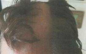 Thợ cắt tóc bị cảnh sát tóm cổ vì cạo đầu khách hàng