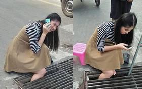 Thái Lan: Mải nghịch điện thoại, cô gái trẻ bất cẩn để lọt chân vào miệng cống ngầm, phải nhờ cứu hộ đến giải thoát