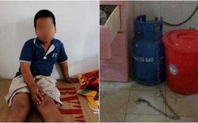"""Vụ bé trai 9 tuổi bị bạo hành: """"Tôi xích chó chứ không xích con"""""""