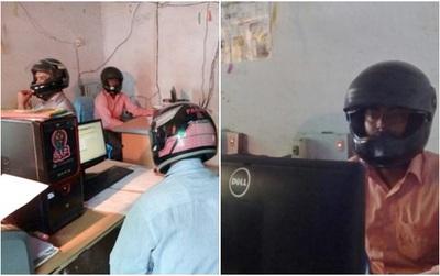 Sợ trần nhà sập vào đầu, nhân viên văn phòng Ấn Độ đồng loạt đội mũ bảo hiểm để bảo toàn tính mạng