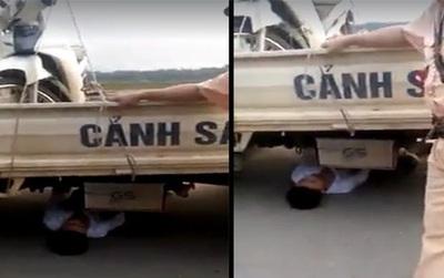 """Vĩnh Phúc: Bị lập biên bản vi phạm giao thông, nam thanh niên 21 tuổi chui vào gầm xe CSGT """"ăn vạ"""""""