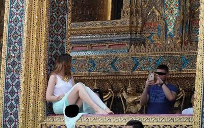 """Nữ du khách ăn mặc """"thiếu vải"""", chụp ảnh phản cảm trong chùa, cư dân mạng phẫn nộ yêu cầu bắt giữ"""