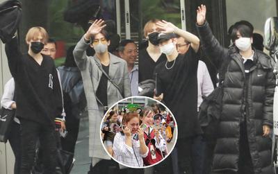 GOT7 cố vẫy chào tại sân bay Tân Sơn Nhất dù trời mưa to, fan Việt gây bất ngờ khi giữ thành hàng ngay ngắn chờ thần tượng