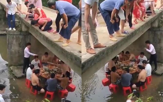 Cái khó ló cái khôn: Nhóm thanh niên kê bàn nhậu dưới gầm cầu, chân buông theo dòng suối để tránh nắng nóng ngày hè