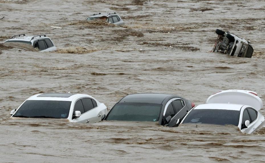 Cảnh tượng ngập lụt, đổ nát kinh hoàng sau bão tại siêu đô thị Busan của Hàn Quốc - Ảnh 8.