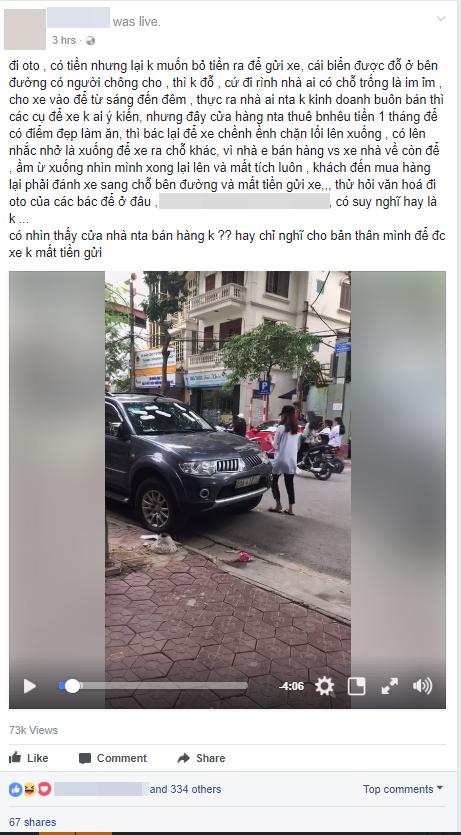 Cô gái trẻ livestream dán băng vệ sinh quanh ô tô vì đỗ trước cửa hàng trên phố Hà Nội gây tranh cãi - Ảnh 1.