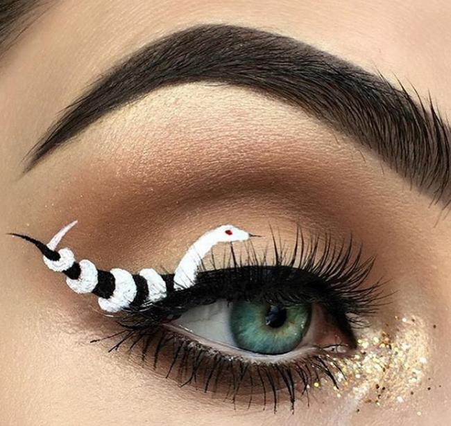 Chào mừng ngày lễ Halloween với kiểu trang điểm mắt đuôi rắn đầy ấn tượng - Ảnh 3.