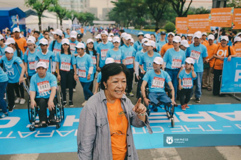 Bộ ảnh xúc động về nghị lực của những người khuyết tật trên đường chạy 5km ở Sài Gòn - Ảnh 2.