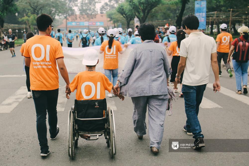 Bộ ảnh xúc động về nghị lực của những người khuyết tật trên đường chạy 5km ở Sài Gòn - Ảnh 11.