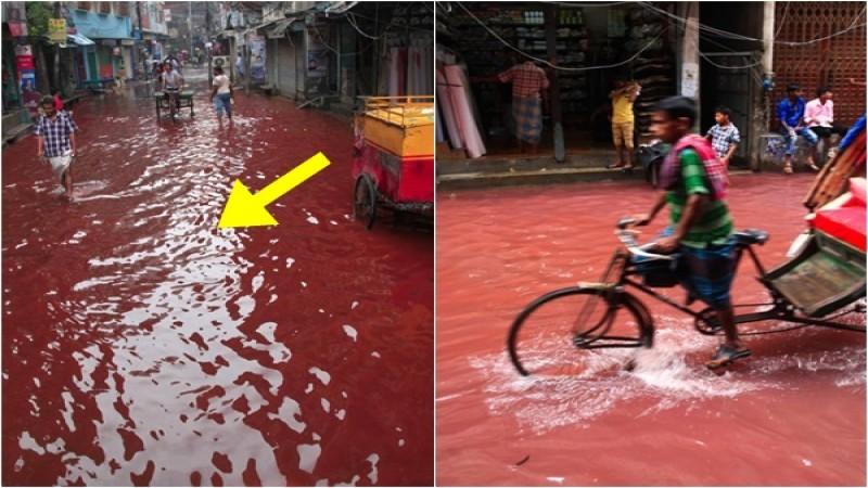 Sự thật đằng sau dòng nước đỏ như máu xuất hiện trên đường sau cơn mưa khiến người dân kinh sợ - Ảnh 1.