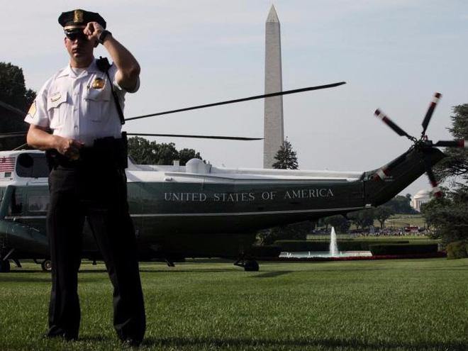 Cận cảnh Đội mật vụ bảo vệ Tổng thống Mỹ Donald Trump - Ảnh 13.