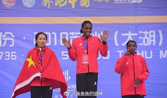 VĐV điền kinh Trung Quốc mất ngôi vô địch, đối mặt với án tù vì lá quốc kỳ - Ảnh 2.