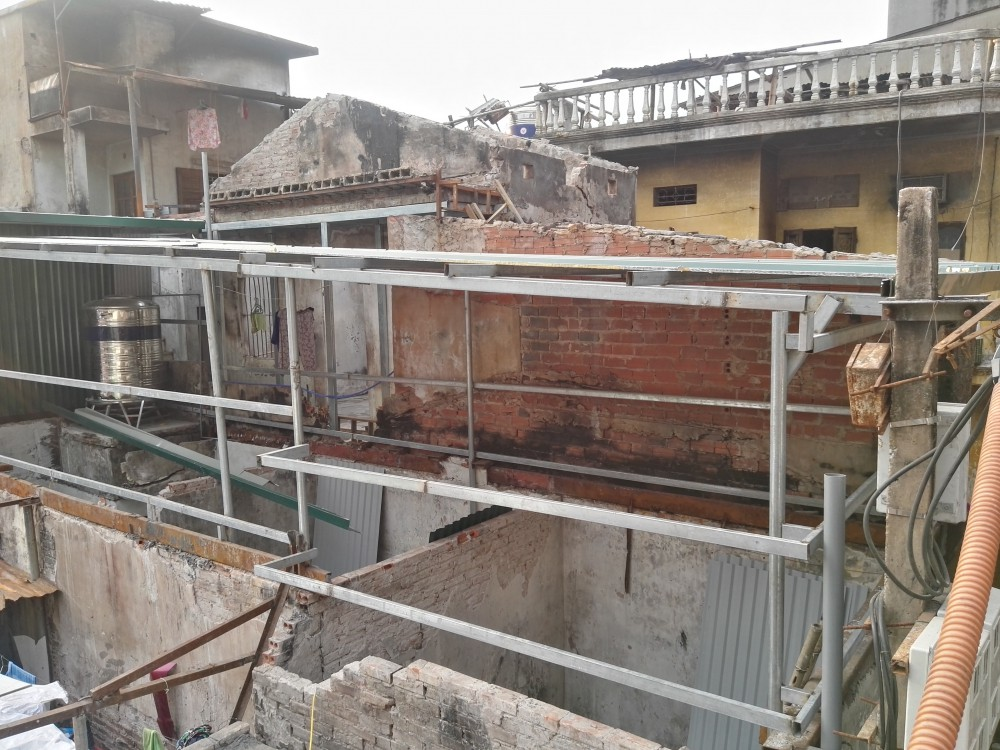 Cháy lớn gần Bệnh viện Nhi Trung ương: Vì sao các hộ dân không được sửa lại nhà hư hỏng? - Ảnh 1.