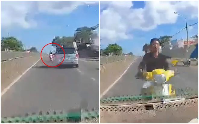 Clip sốc: Phóng xe máy ngược chiều trên quốc lộ, nam thanh niên lao thẳng vào đầu ô tô bị thương nặng - Ảnh 2.