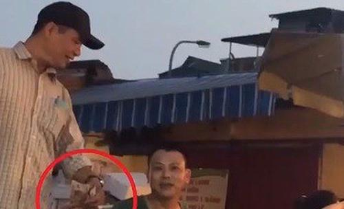Khởi tố, bắt tạm giam 3 đối tượng trong vụ bảo kê chợ Long Biên - Ảnh 2.