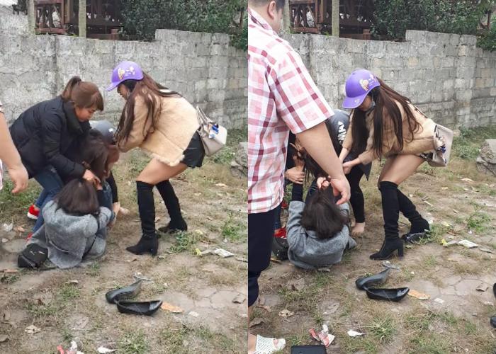 Cô gái trẻ bị túm tóc, đánh ghen ngay giữa đường vào trưa 30 Tết vì cặp kè với đàn ông đã có gia đình - Ảnh 1.