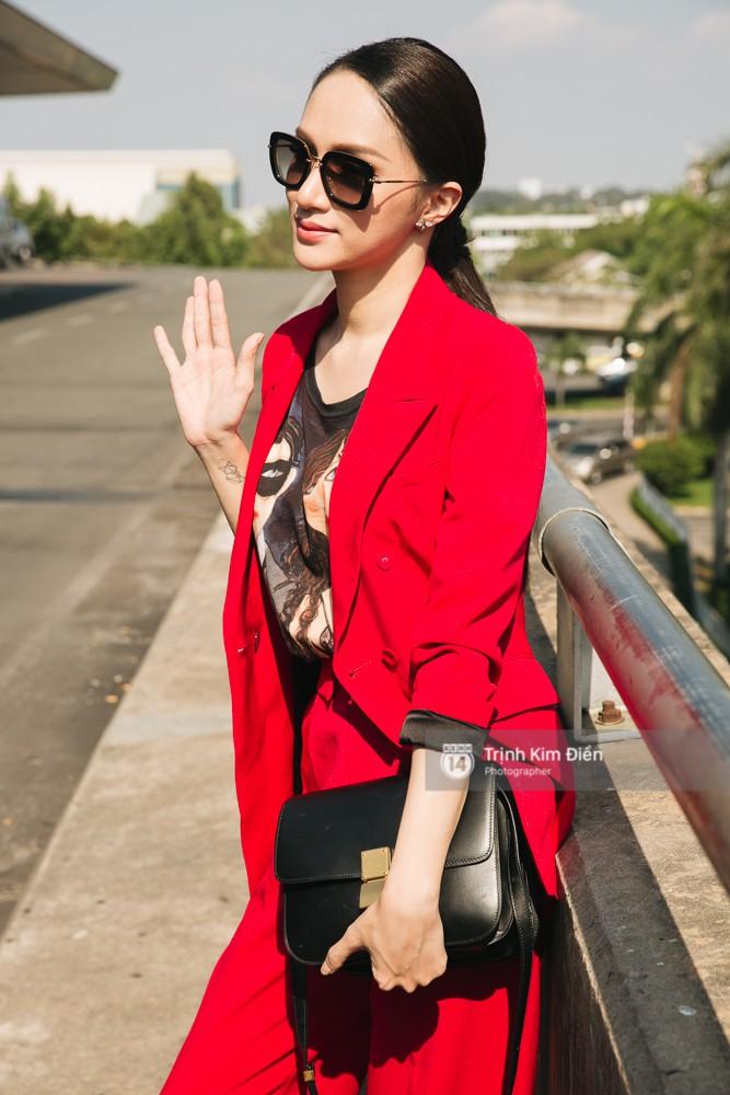 Hương Giang diện nguyên cây đồ đỏ rực, mang theo 105 kg trang phục đi chinh chiến Hoa hậu Chuyển giới Quốc tế - Ảnh 12.