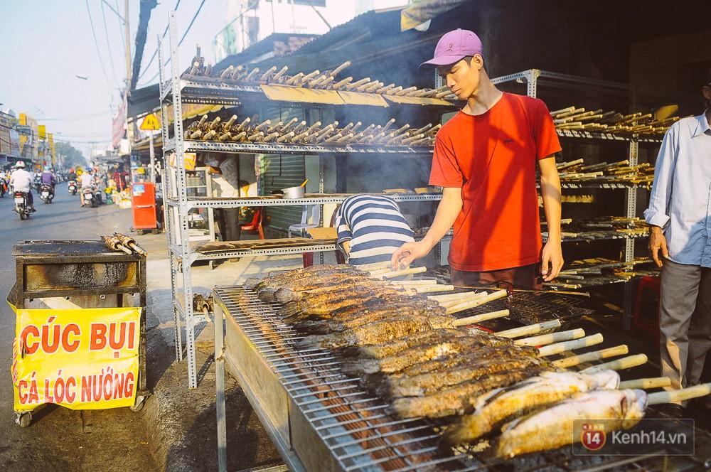 Hàng chục tấn cá lóc giá 150.000 đồng/con được tiêu thụ trong ngày Thần tài ở Sài Gòn - Ảnh 1.