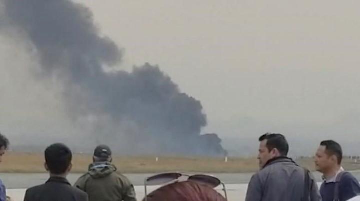 Ảnh: Hiện trường vụ máy bay gặp nạn khi hạ cánh ở Nepal, 50 người chết - Ảnh 9.