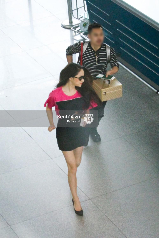 Hương Giang vội vã ở sân bay Tân Sơn Nhất, suýt muộn chuyến bay quay lại Thái Lan vì kẹt xe - Ảnh 11.