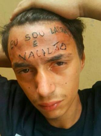 Thanh niên Brazil nổi tiếng vì hình xăm Tôi là kẻ trộm trên trán vừa bị bắt vì tội... ăn trộm - Ảnh 1.
