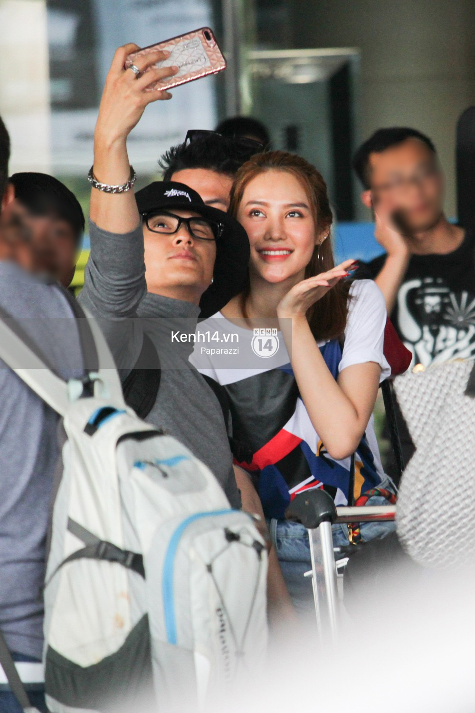 Lâm Vinh Hải - Linh Chi xuất hiện vui vẻ, tình cảm selfie cùng nhau tại sân bay Tân Sơn Nhất - Ảnh 9.