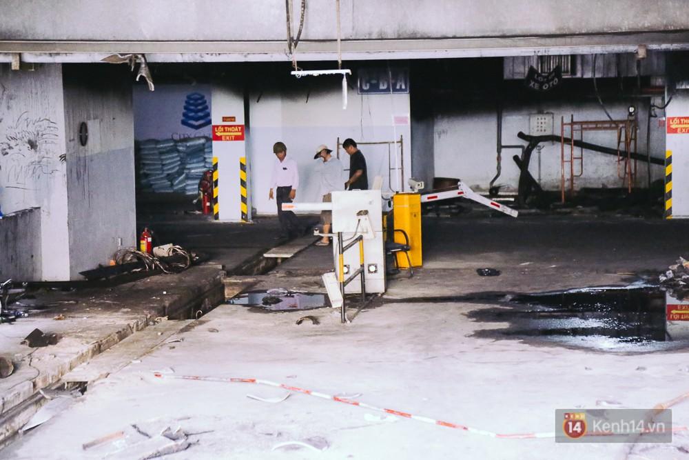 Ớn lạnh hiện trường nơi ngọn lửa bùng phát tại hầm chung cư Carina khiến 13 người tử vong - Ảnh 1.