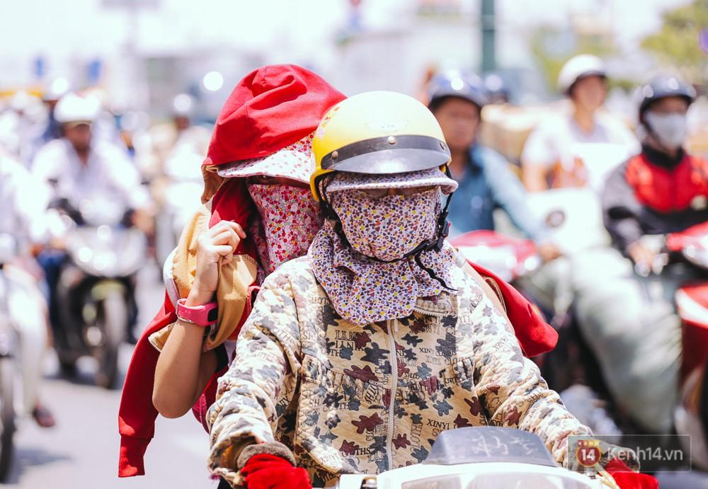 Chùm ảnh: Sài Gòn bước vào đợt nắng nóng đổ lửa, những ninja xuống phố - Ảnh 5.