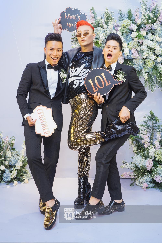 Trấn Thành bảnh bao, Hà Anh khệ nệ vác bụng bầu 7 tháng dự đám cưới John Huy Trần và bạn trai - Ảnh 7.