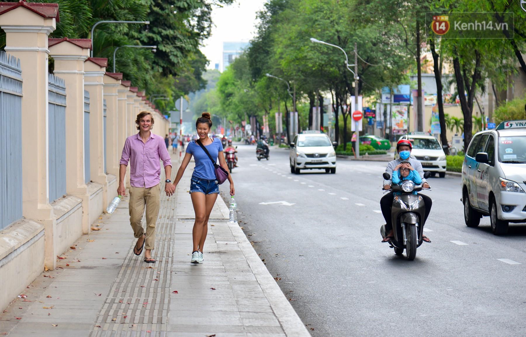 Chùm ảnh: Những ngày này, có một Sài Gòn tĩnh lặng lạ thường khi người dân đã rủ nhau đi trốn - Ảnh 9.