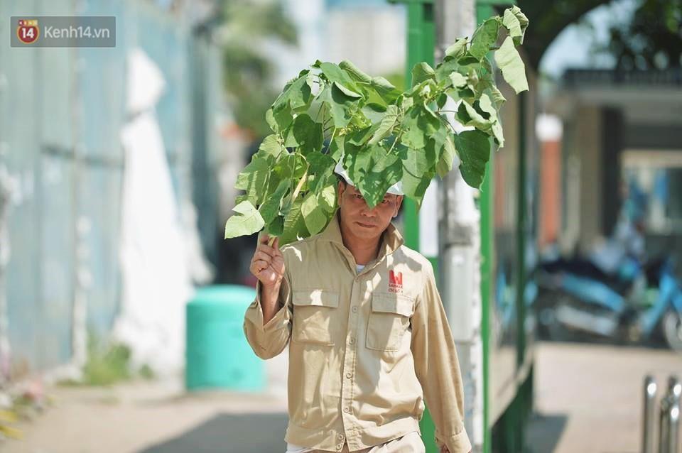 Nhọc nhằn bước chân mưu sinh của những người lao động nghèo dưới nắng nóng Hà Nội - Ảnh 9.