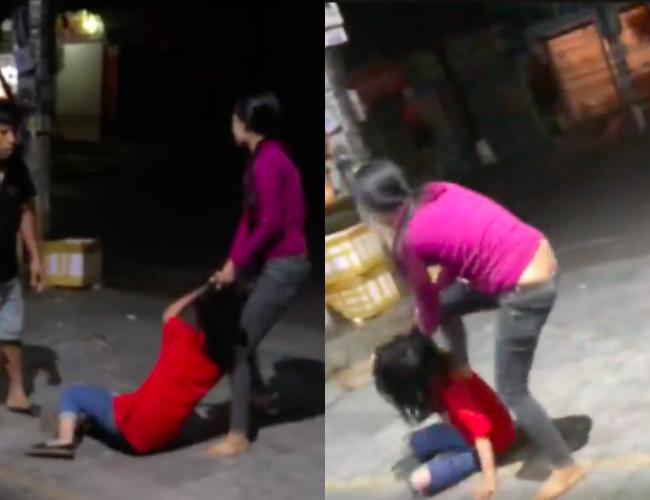 Thấy vợ lao vào túm tóc, đập đầu nhân tình xuống đường, người chồng can ngăn không được liền phóng ô tô bỏ đi - Ảnh 1.
