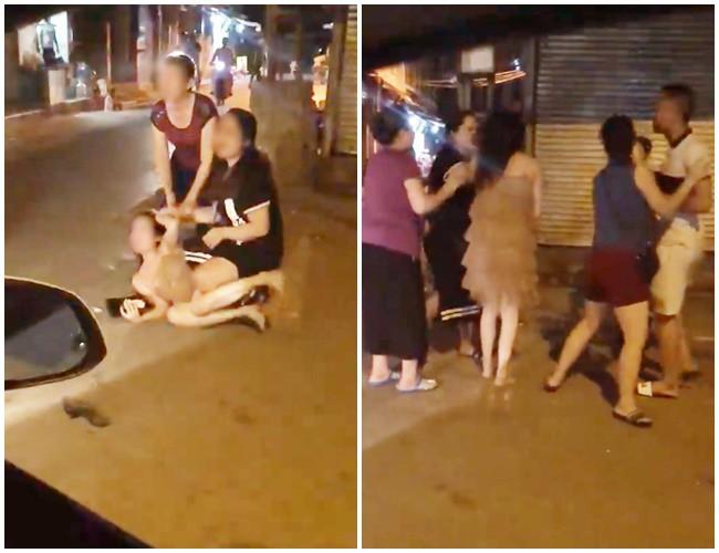 Hot girl xinh đẹp bị túm tóc đánh ghen ngay trên phố Hà Nội