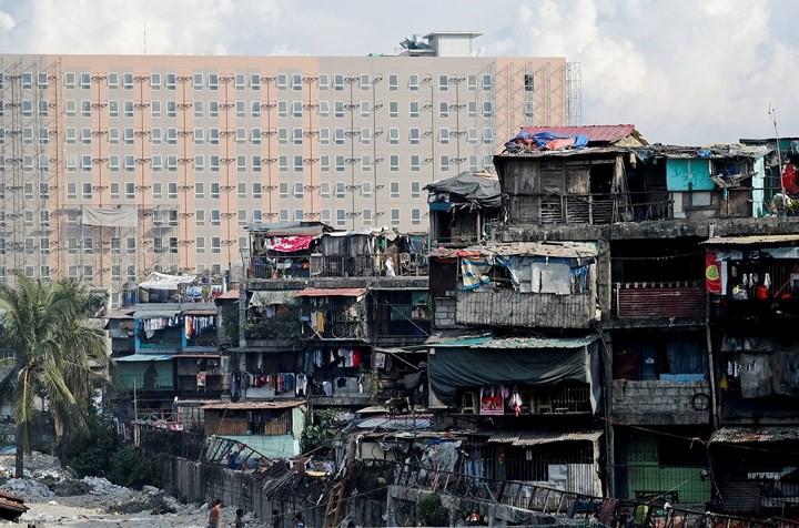 Ảnh: Cảnh tượng đau lòng trong những khu ổ chuột bị thiêu rụi ở Philippines - Ảnh 1.