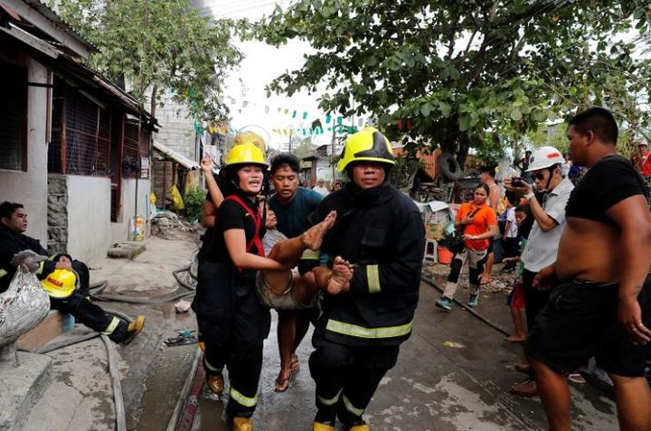 Ảnh: Cảnh tượng đau lòng trong những khu ổ chuột bị thiêu rụi ở Philippines - Ảnh 10.